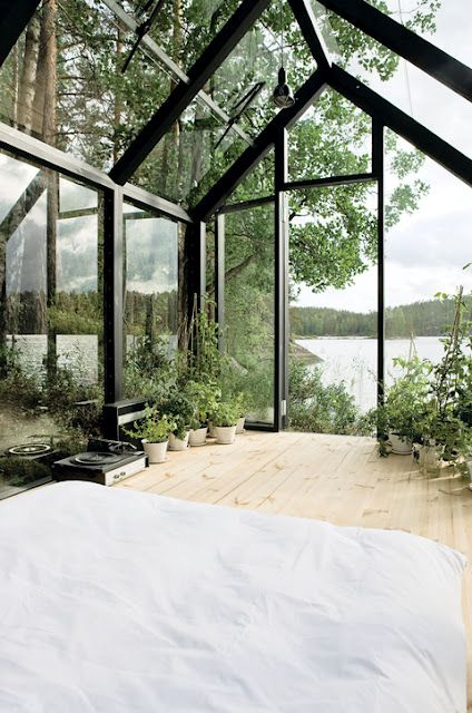 Greenhouse living at it's finest. This glass house was designed and built in Finland.