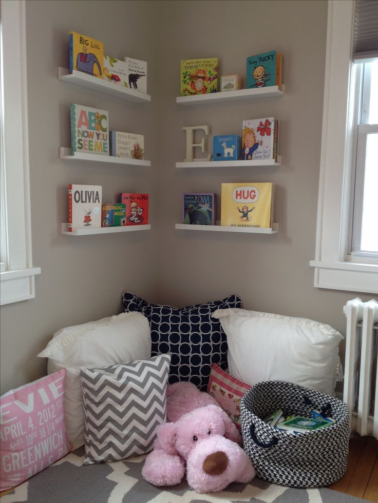Another peak into my daughter's room!  If your child's books are quickly taking over your house, try getting some off of the floor.  Use picture ledges to display books in your child's bedroom or play area.  You can easily rotate them according to everyone's current favorites.  Here, I created a toddler friendly reading corner.