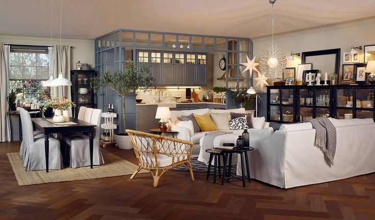 Open plan kitchen and living room in beige, grey and black