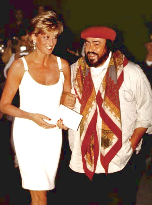 September 12, 1995: Diana is greeted b Pavarotti on arrival in Moderna, Italy for a concert to raise money for Bosnian children.
