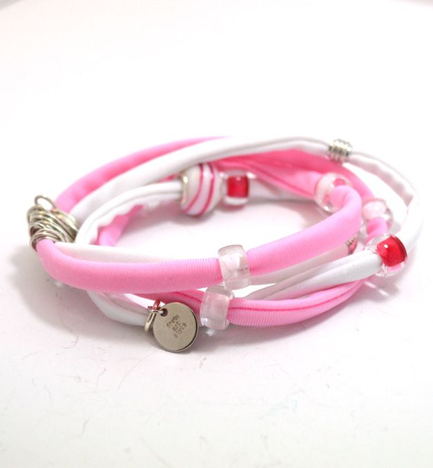 Douple lycra cord in pink and white embellished with unique glass beads and handmade silver wire detail. Length approx. 40 cm. Each. Two (2) turns each round the wrist. Adjustable bracelet, fits to all wrist sizes. Comes in a gift box.   get it now @ www.freeartstyle.com