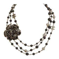 Chanel Black Three Strand Bead Necklace W/ Rhinestone Camelia