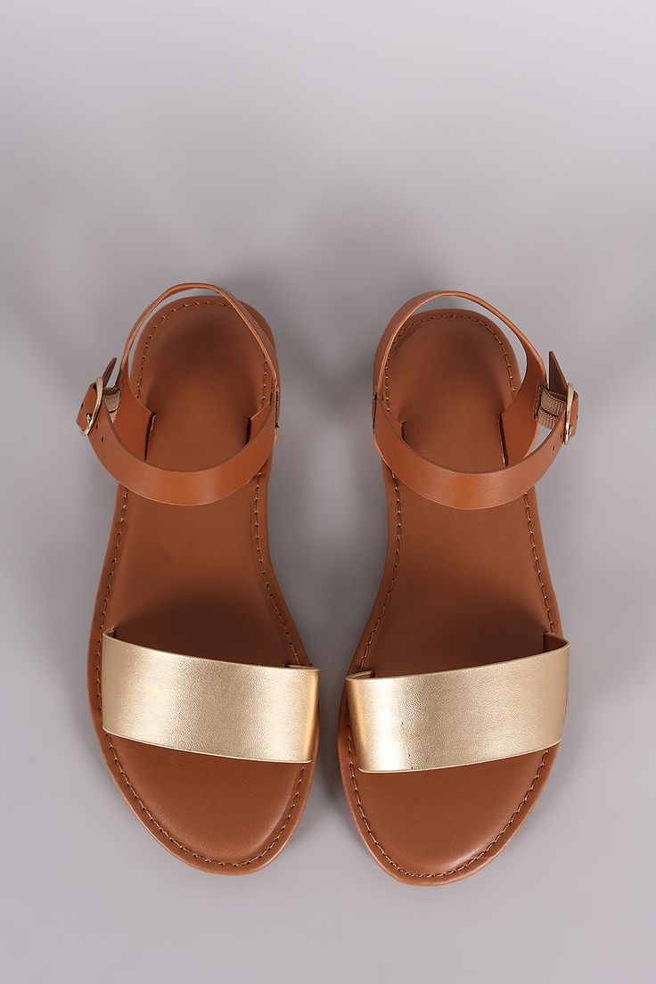 Description This flat sandal has a single band across the vamp featuring an adjustable ankle strap Material Vegan Leather manmade Sole Rubber