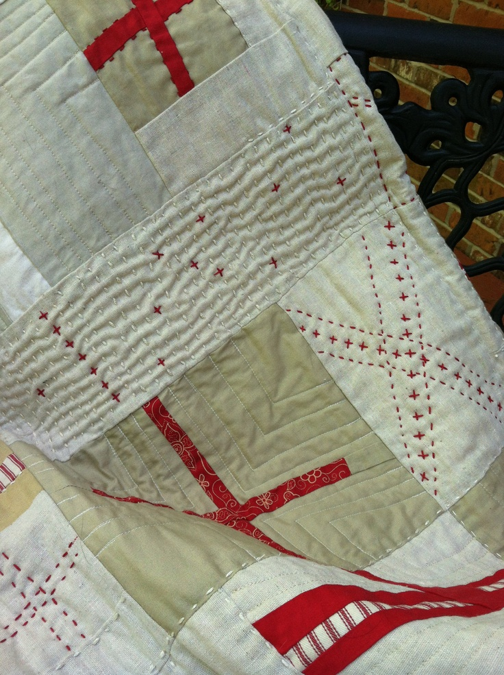 Close-up detail of embroidery & stitching on Red Cross Quilt