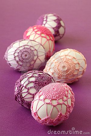 Pink and purple crochet Easter eggs by Ingrid Heczko, via Dreamstime