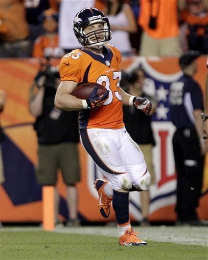 Denver Broncos wide receiver Wes Welker scores a touchdown against the Baltimore Ravens during the second half of an NFL football game, Thursday, Sept. 5, 2013, in Denver. (AP Photo/Joe Mahoney)