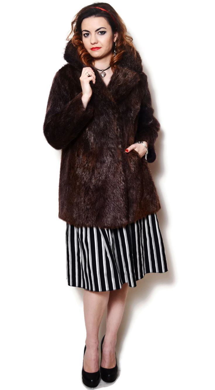Vintage real fur coat. There are a few tiny stains on the lining.  The model on the pictures is size S/36 and 165 cm height. Please check measurements with your own to avoid problems with the size. Make sure you double the measurements where shown (*2):  Label size: M/38 Total lenght: 79 cm / 31.25 inches Sleeve lenght: 56.5 cm / 22.25 inches Shoulder to bottom: 71.5 cm / 28.25 inches Armpit to bottom: 49 cm / 19.25 inches Armpit to armpit: 51 cm *2 / 20.25 ...