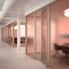 Pin 2: This frosted peach coloured glass is a great way to add a touch of colour and brighten up an office space, while also giving the rooms some privacy. It is a pleasant change from the plain glass walls after seen in many office spaces. Materialist