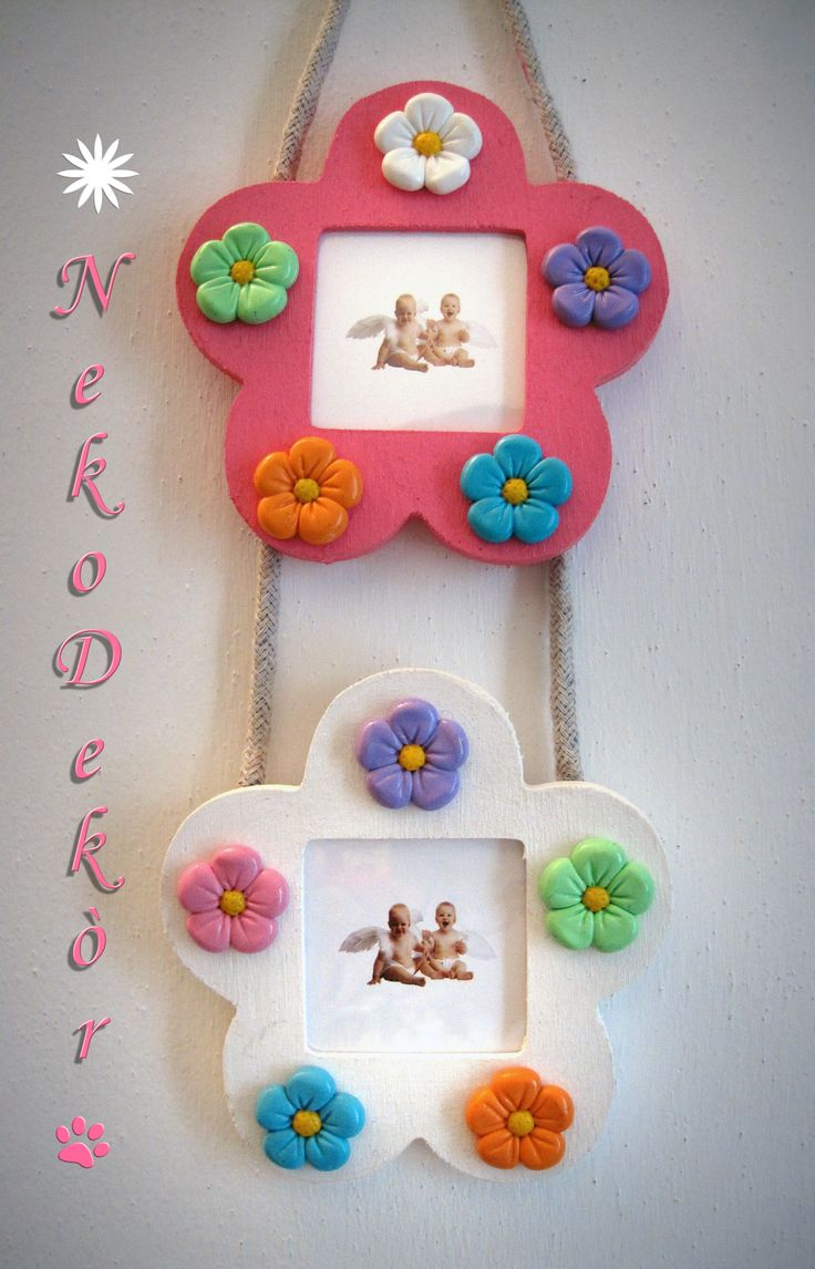 Size: Width 11,6 cm / Height 11 cm  Wodden flower-shaped frame with handmade fimo colorful flowers.