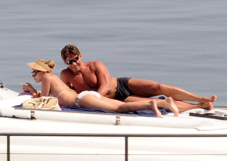 Pin for Later: Jet Set With the Best Celebrity Vacations  Scarlett Johansson got her tan on in a white bikini while floating around Sicily in July 2012.