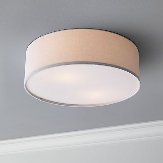 halo glow.  Small changes make a big difference.  Elevate the standard lighting down the hall and or center of the ceiling with this understated light that spans nearly two feet.  Broad, low-slung circle diffuses a soft glow in clean, white linen.  Simple, shallow profile is a perfect fit for lower ceilings.