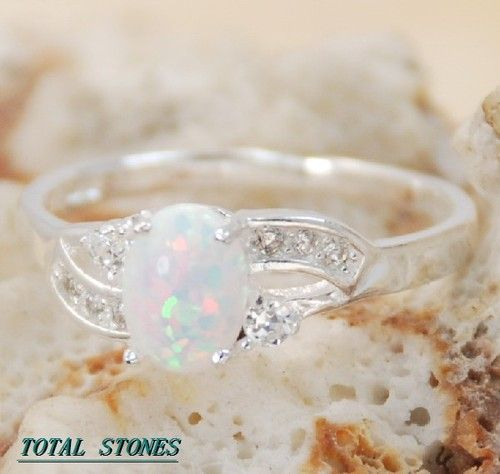 WHITE FIRE OPAL instead of a diamond for an engagement ring! I love it!