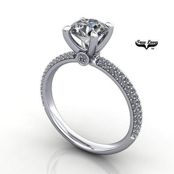 This beauty pave set engagement ring.....  #ring #moissanite  #rings #fashionjewelry #jewelrygram #engagementring #jewelrydesign #jewelryaddict #weddingrings #showmeyourrings #ringbling #weddingblog #weddingforward #heputaringonit #futurewife #isaidyes #gettingmarried #proposal #couplegoals #marryme #bridetobe #engagement #instawed #finejewelry #perfectproposal #wifetobe #bridesmaid #fiancee #ohsoperfectproposal #trekjewellers