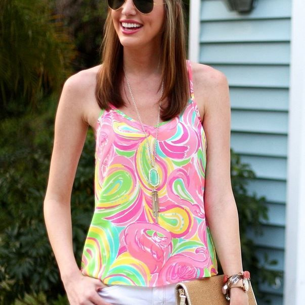 Lilly Pulitzer Dusk Racer Back Tank Top shown in Multi All Nighter and the Lilly Pulitzer Happy Hour Clutch styled via @courtneyannriley Instagram.