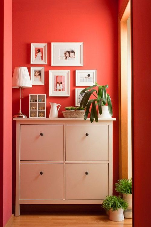 be bold with color.  this red is the perfect back drop to the clean lined dresser and family photos.