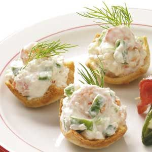 """Shrimp Toast Cups """"These appetizers always disappear quick as a flash,"""" says field editor Awynne Thurstenson of Siloam Springs, Arkansas. """"The pretty toast cups lend themselves to other favorite fillings, too!""""  6  Rate  Print  Grocery List  Recipe Box  Email      Shrimp Toast Cups Recipe  Prep: 30 min. Bake: 15 min./batch Yield: 48 Servings  30  15  45  Ingredients  24 slices white bread, crusts removed  1 cup butter, mel"""