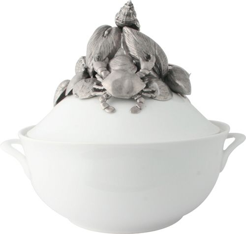 The lid of Vagabond House's generously sized, elegant porcelain soup tureen is topped by an intricately detailed pewter figural mélange of marine life.