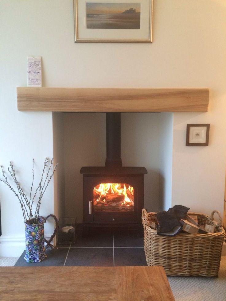 Log burning stove with oak mantle wood burning stoves - Living room with wood burning stove ...