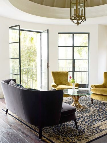 dark grey sofa, yellow accents, and a gorgeous rug.