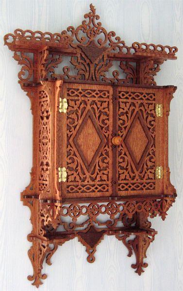 Hanging wall cabinet, scroll saw fretwork pattern