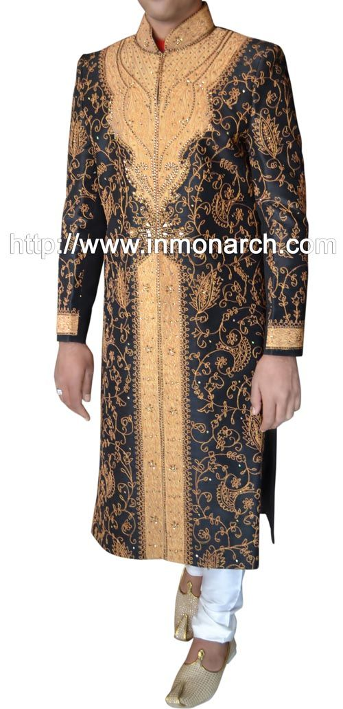 Fashionable designer work indian wedding sherwani made from black color pure silk fabric. Hand embroidered as shown. It has bottom as chudidar made from dupion fabric in white color.