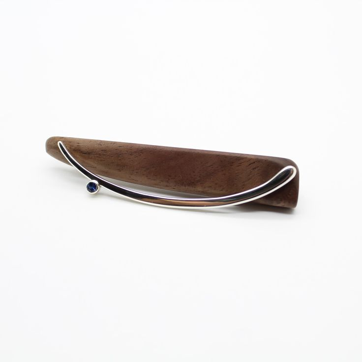 Brooch. Wood, sterling silver, blue sapphire