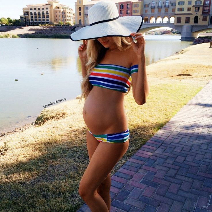 Rainbow swimsuit and baby bump:
