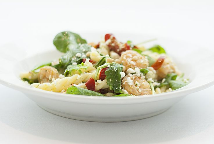 Shrimp Gemelli Pasta with cherry peppers, arugula, and feta cheese in a basil vinaigrette. Sprinkled with pine nuts!