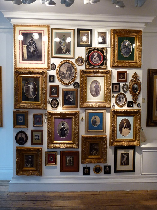 Photo wall art arrangement family photos to the floor