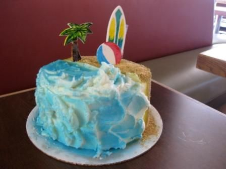 This cake has some of the coolest decoration I have ever seen! whoever frosted those waves is my hero, they look SO good!