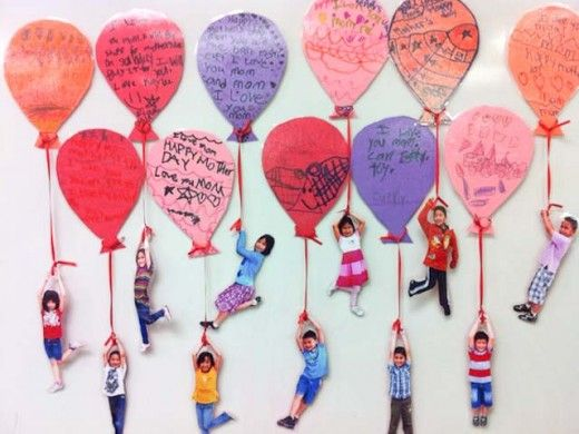 Kid photos hanging from balloon messages for Mother's Day...fun!
