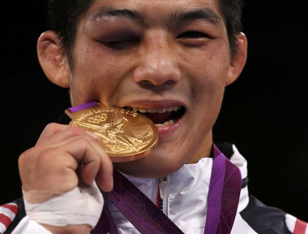 Best photos of the London Olympics - South Korea's Hyeonwoo Kim bites his gold medal at the podium of Men's 66Kg Greco-Roman wrestling at the ExCel venue during the London 2012 Olympic Games August 7, 2012. (REUTERS/Damir Sagolj)