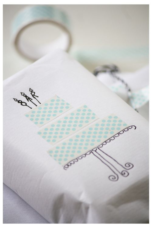 Create a layer cake out of washi tape using the colors of the wedding. Can be put on a card or the gift itself.