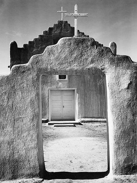 "Church, Taos Pueblo. Front view of entrance, ""Church, Taos Pueblo National Historic Landmark, New Mexico, 1942"" [Misicn de San Gercnimo] (vertical orientation)"