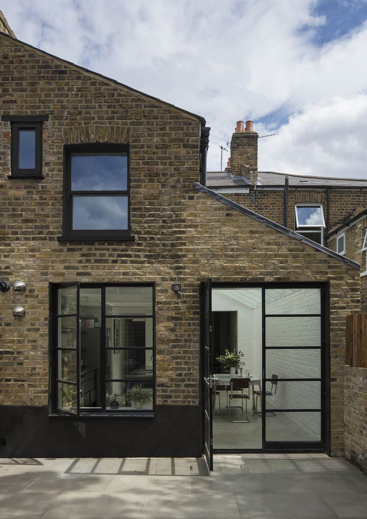 Crittall door and windows from Metwin Windows at metwin.co.uk (John Norman at mustardandarchitects.com)  - black windows on red brick to show option for blending old with new