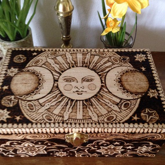 The Sun, Moon and Wishing Stars shine brightly around this beautifully pyrographed wooden box. This box measures 3 1/2 inches tall, 8 1/2 inches