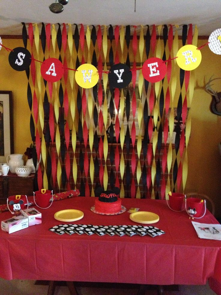 Mickey Mouse party  On back wall with window.--Done so cute made with son's name and ears on the black circle