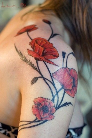 Red flowers shoulder tattoo