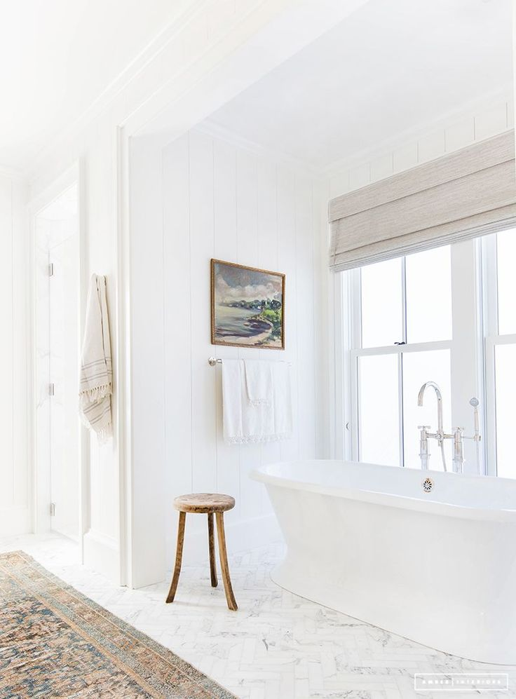 White bathroom with freestanding tub