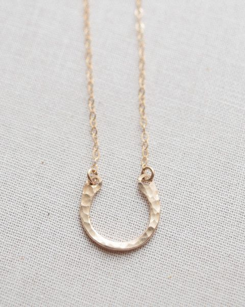 Hammered Horseshoe Necklace is handmade in silver, gold and rose gold. Petite hammered horseshoe charm measures approximately 1/2 inch in diameter.