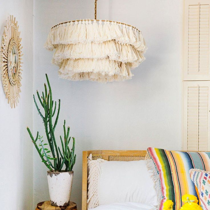 We're obsessed with tassels at the Jungalow and pretty much want to put them on everything we own. The Fela Tassel Chandelier designed by Justina Blakeney for t