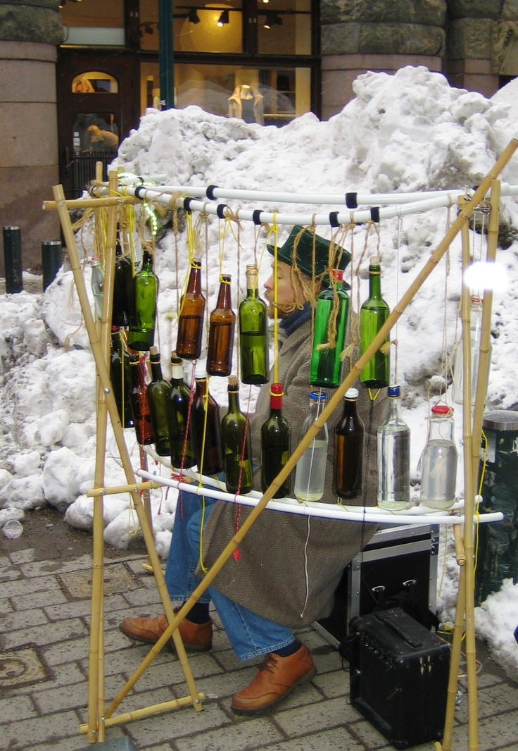 A street musician playing with water bottles in Helsinki, Finland.
