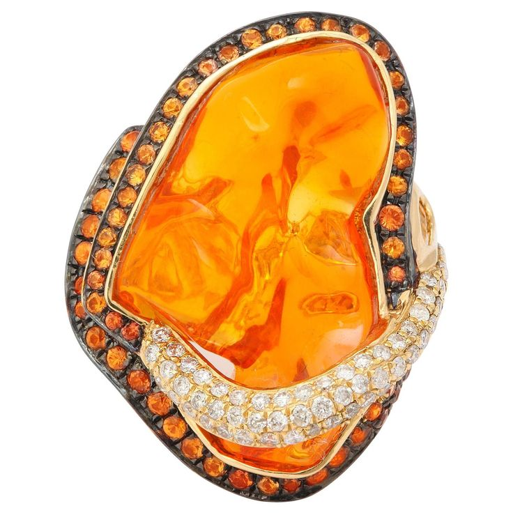 Mexican Opal Orange Sapphire Diamond Gold Ring   From a unique collection of vintage cocktail rings at https://www.1stdibs.com/jewelry/rings/cocktail-rings/