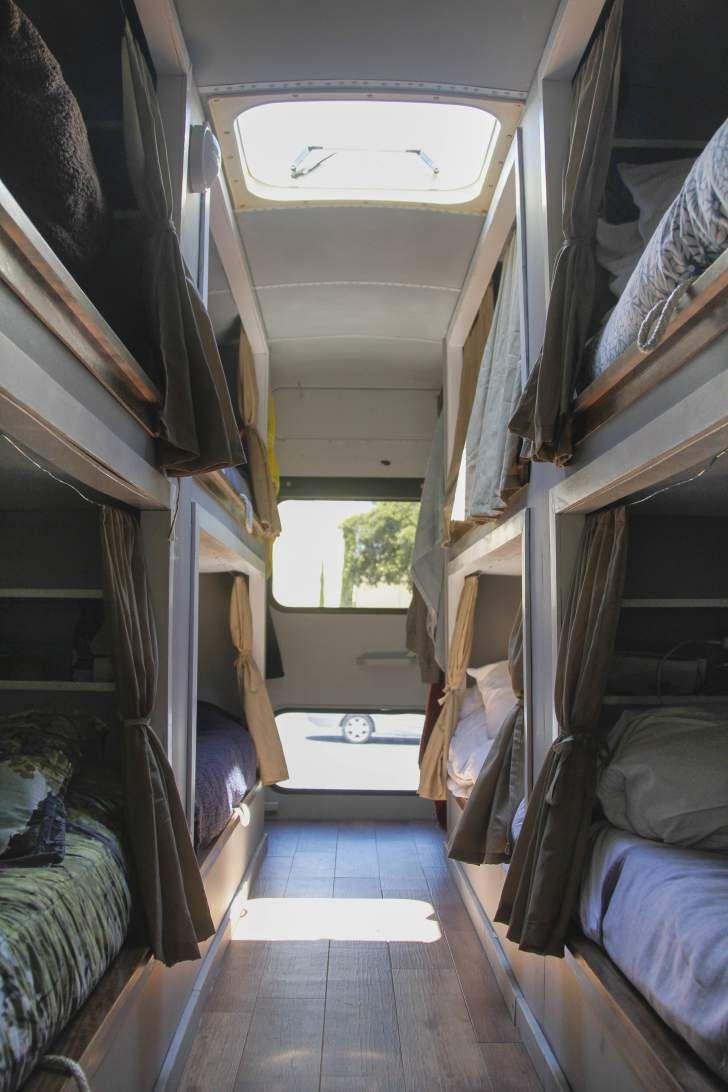 Sleeping bunks in converted school bus.