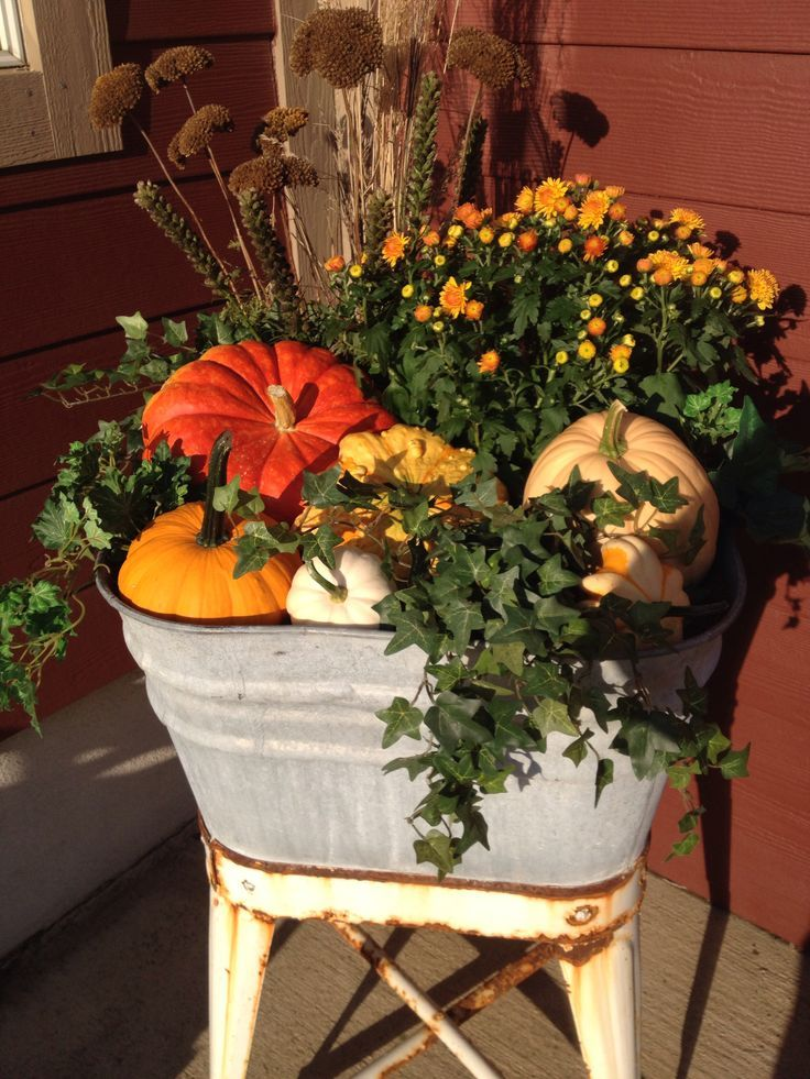 Vintage wash stand willed with fall pumpkins and mums