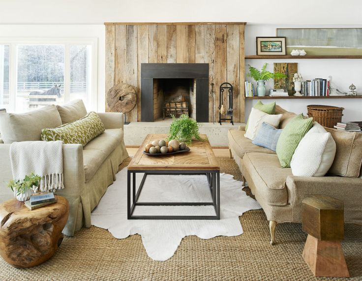 Natural Materials Accentuate This Room Slipcovered Sofas And Cowhide Sisal Rugs Add Softness Texture Verdant Pops Of Green Reinforce The
