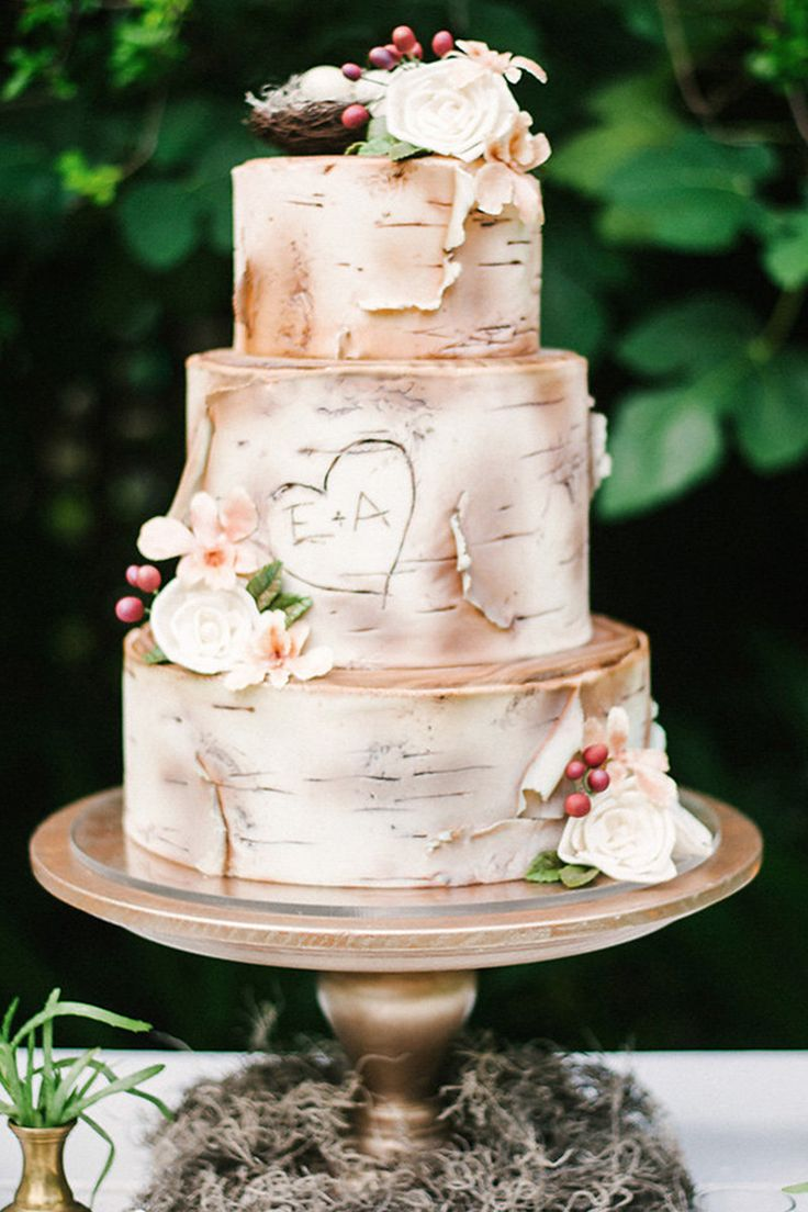 You may not be a traditional couple, but you still want your cake! It can be a showpiece, but in a cool eclectic boho chic sort of way. Think natural wood, birds, florals and feathers. Photographers:  	Kailey Faith Photography 	Cakes & Catering:  	Imaginary Cakes  View Post:  	Boho Garden Wedding