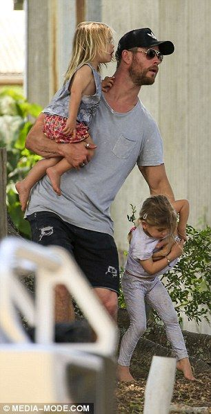 Chris Hemsworth cradles his children as he joins wife Elsa Pataky near Byron Bay | Daily Mail Online