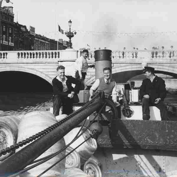 Guinness Liffey barge passes O'Connell Bridge (c.1950)  A Guinness Liffey Barge en route back to the Brewery having passed under O'Connell Bridge.  © Guinness