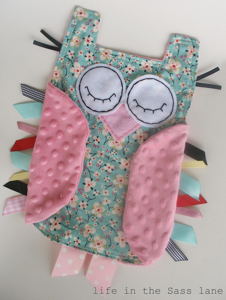 super easy ribbon blankie idea to make - for the wings, I just turned and top stitched and then sewed them into the rest of the owl along with the ribbons, for the eyes I used embroidery floss, and to put it all together I turned and top stitched including the wings so the wings were folded down and you could still see the ribbons. a super cute baby shower idea - especially if you love owls :)